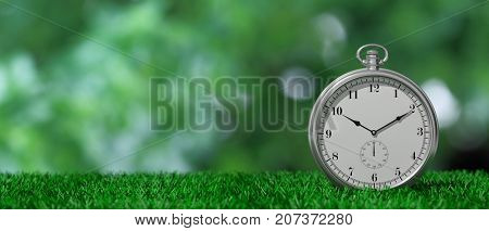 Silver pocket watch isolated on green grass and green abstract background, copy space. 3d illustration
