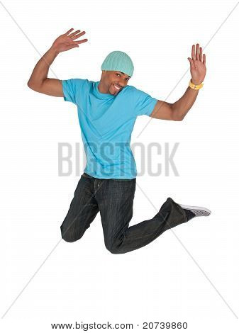 Smiling Guy In A Blue T-shirt Jumping For Joy