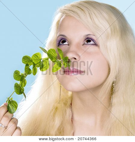girl blonde enjoys aroma of mint