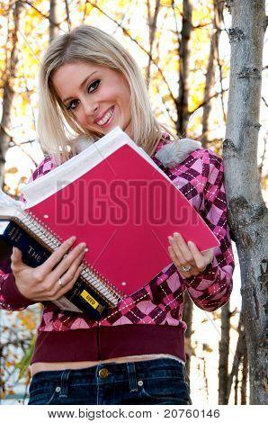 Woman Holding Schoolbooks