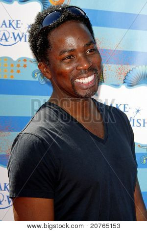 SANTA MONICA - MAR 14: Harold Perrineau at the Kevin + Steffiana James + Make-A-Wish Foundation Host A Day of Fun at the Santa Monica Pier in Santa Monica, California on March 14, 2010.