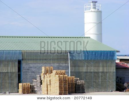 A Pile Of Pallets Of Concrete Blocks At A Factory On The Outskirts