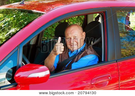 Senior as a car driver in the car.