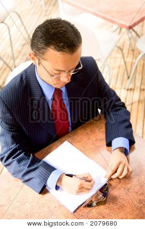 Business Man Filling A Questionaire