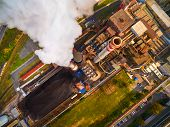 Aerial view of modern combined heat and power plant. Fuming chimney with sulphur removal unit. Heavy poster