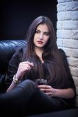 Beautiful Young Woman Relax In Night Club. poster