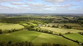 Aerial photo over countryside in rural West Berkshire, England, UK poster