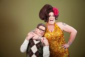 foto of snatch  - Large drag queen holds a surprised nerd around his neck - JPG