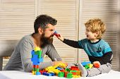 Family And Childhood. Man With Beard And Boy Play Together poster