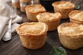 Delicious meat mini pies on table, closeup poster