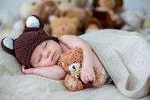 Little Newborn Baby Boy, Sleeping With Teddy Bear At Home In Bed poster