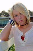Young Blond Woman Reminiscing On School Grounds