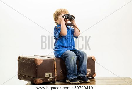 poster of Little Boy With Suitcase And Binoculars. Holidays, Adventure, Travel Concept. Vacation, Travel, Jour
