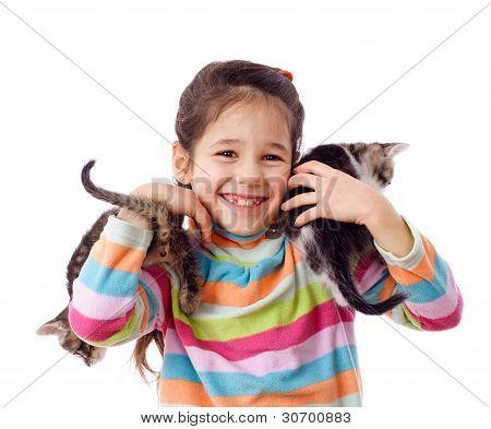 Happy little girl cuddle two kitten