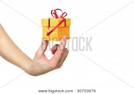 Female Hand Holding Red And Yellow Gift Box With A Bow