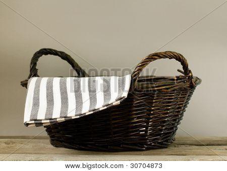 an empty wicker basket on a gray background