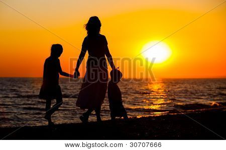 Mother and her kids silhouettes