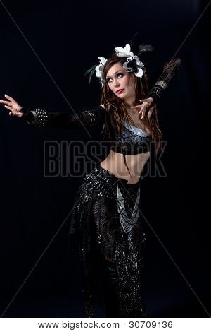 Attractive bellydancer  dancing in tribal makeup