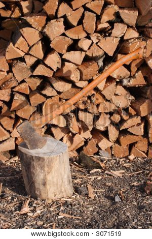 Ax In Front Of Wood Pile