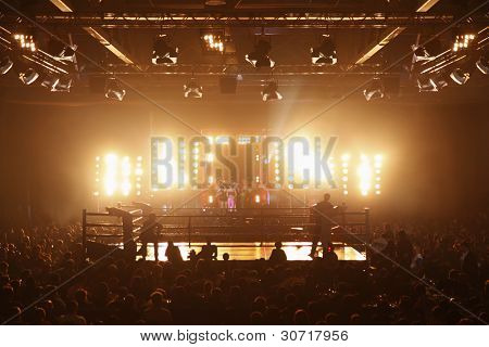 MOSCOW - MARCH 12: Stylist Sergei Zverev and his team stand near boxing ring before fight at Fight Nights Battle of Moscow-3 in Crocus City, on March 12, 2011 in Moscow, Russia.