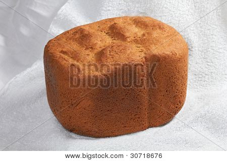 Closeup of rye wheat leavened bread on white tablecloth