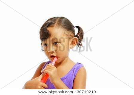 Asian Little Girl Enjoy Biting Ice Syrup
