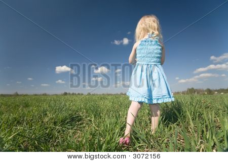 Little Girl On Wide Green Meadow