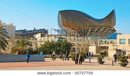 BARCELONA, SPAIN - JANUARY 22: Peix sculpture in Port Olimpic on January 22, 2011 in Barcelona, Spain. The sculpture of a huge fish, designed by famous Frank Ghery, 35 meters high and 54 meters long