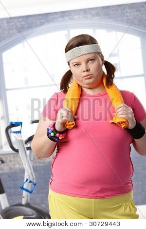 Exhausted fat woman after workout at the gym.?