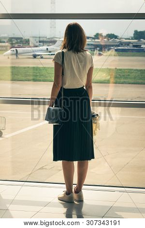 poster of Traveler Girl On Airport In Vacation. Young Traveler Girl In Vacation. Girl Traveling By Airplane In