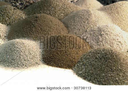 Various Brown Toned Sand Piles Together