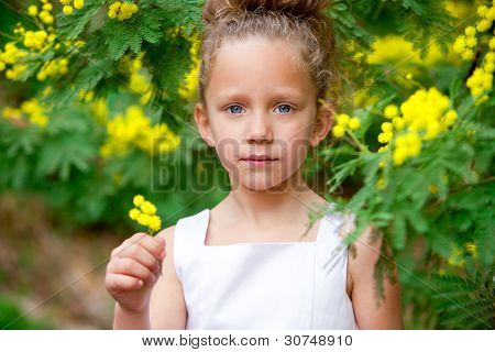 Cute Girl In Garden With Flowers.