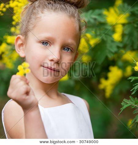 Portrait Of Cute Girl With Flower Oudoors.