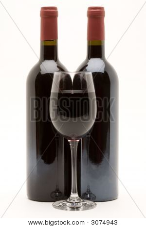 Red Wine Bottles With Filled Wineglass