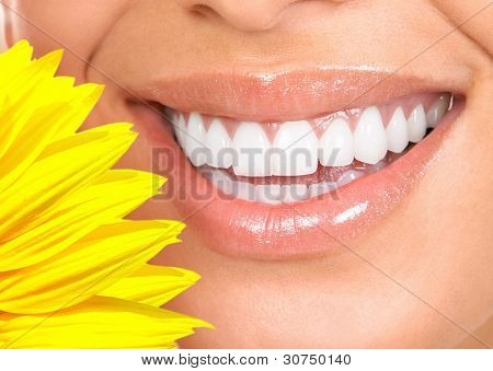 Happy smiling woman with a healthy teeth. Dentist.