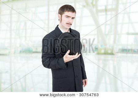 young man dressed as vintage businessman at the office