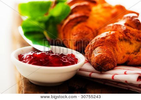 Fresh Croissant On A Wooden Plate On White Background As A Studio Shot