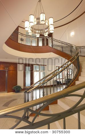 Home entrance with spiral staircase