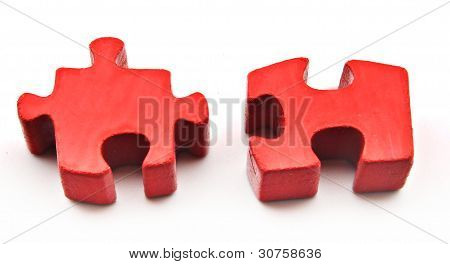 Two puzzle pieces red
