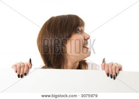Close-Up. Beautiful Woman Holding A Billboard.