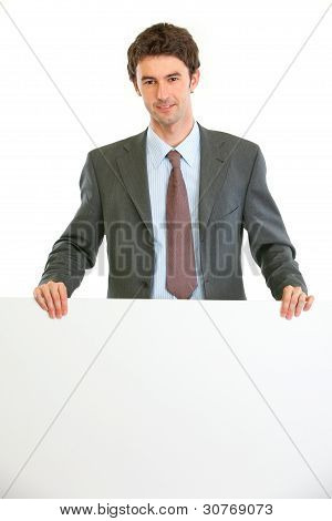 Modern Business Man Showing Blank Billboard