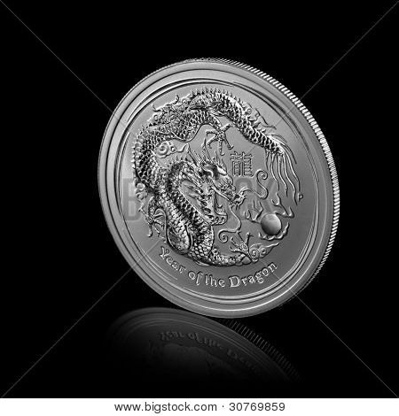 year of dragon. silver coin isolated on black