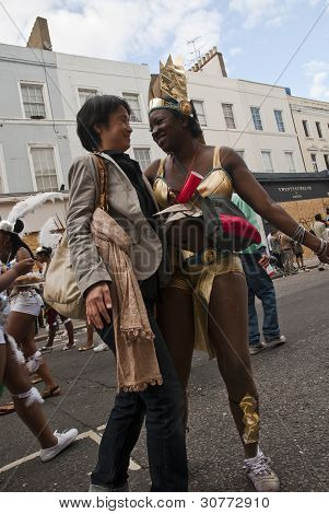 Dancer From The Genesis Carnival Float Has Fun With A Passerby At The Notting Hill Carnival