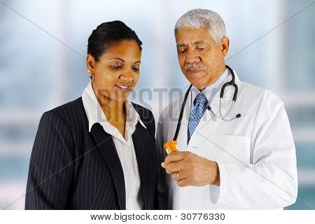 Man giving a prescription to his customer