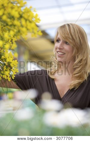 Pretty Blond Woman In Garden Center