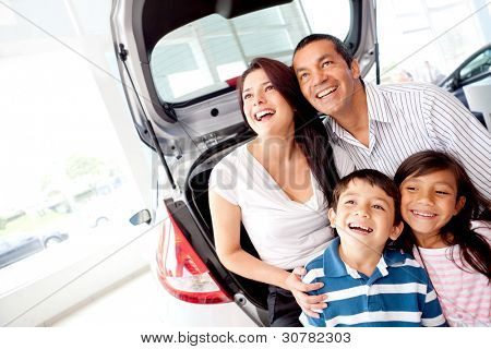 Happy family at the dealership buying a car