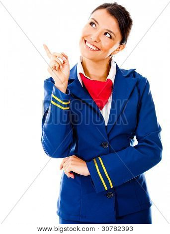 Toughtful flight attendant pointing - isolated over a white background