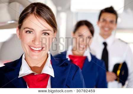 Air hostess with the airplane cabin crew smiling