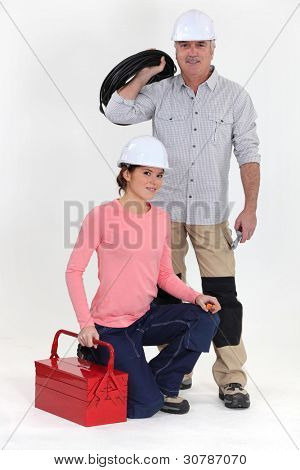 An electrician and his apprentice.