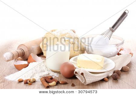 Ingredients for the dough wooden table on white background